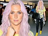 Changing it up AGAIN: Kesha debuted her bubble gum pink hair as she arrived at LAX on Saturday