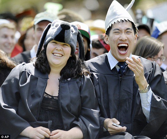Well-received: Miriam Rock (left) of Philadelphia and Jack Shu (right) of Potomac, Maryland react as Secretary of State John Kerry delivers the Class Day address at Yale University, Sunda