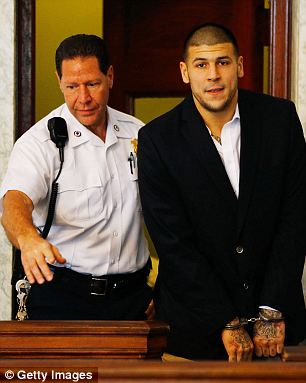 More charges: Aaron Hernandez has been charged with two additional counts of first-degree murder in connection with a 2012 double murder in Boston