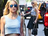 Way to stop traffic! Kate Hudson flashes rock hard abs and a body chain as she struts around New York