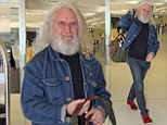 He's a long way from home! Billy Connolly walks through Sydney airport after wrapping up his recent tour