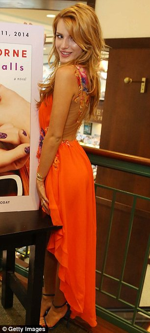 It's not all fun and games: The star also attended a meet and greet at Barnes And Noble in an orange dress
