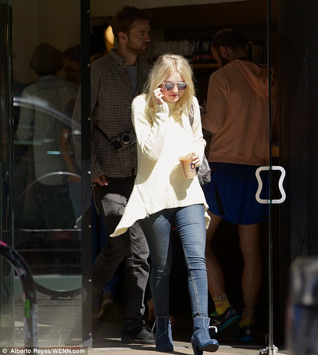 Caffeine fix: The blonde actress picked up her iced coffee at La Colombe during the sunny day