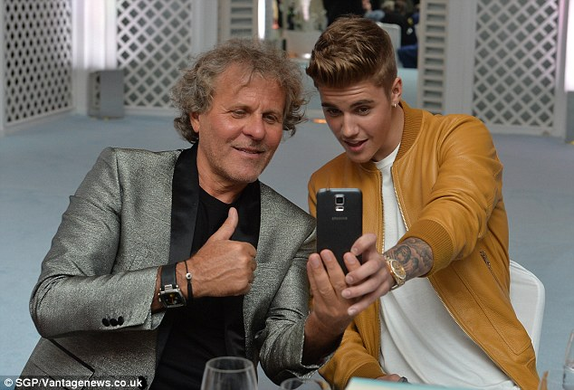 Selfie obsessed: Justin went on the rampage as he took various pictures on his phone with guests at the party