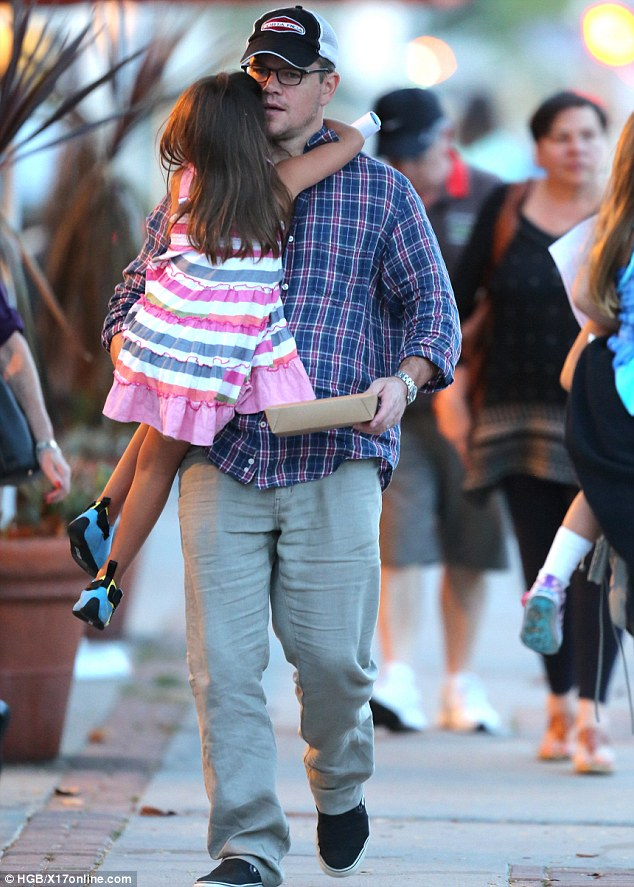 Proud poppa: The actor happily carried his daughter Luciana during his family stroll