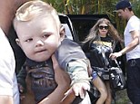 A star is born! Fergie and Josh Duhamel are upstaged by their adorable and inquisitive son Axl as they return home from fun family day out