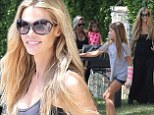 Denise Richards flashes a smile as she enjoys some family bonding with daughters Sam and Eloise