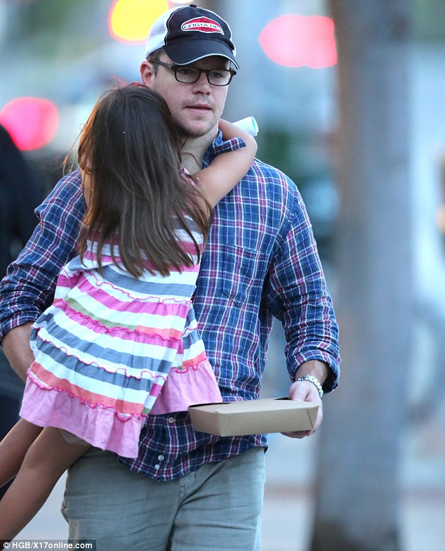 Multitasker: Matt was able to life his daughter in one arm and use the other to carry food to-go