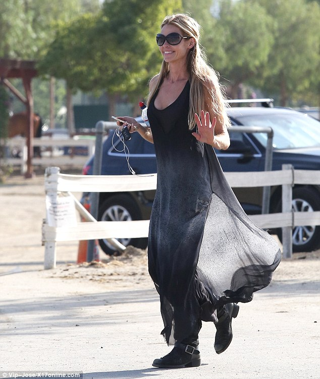 Enthused: The slim mother looked excited while approaching the equestrian center