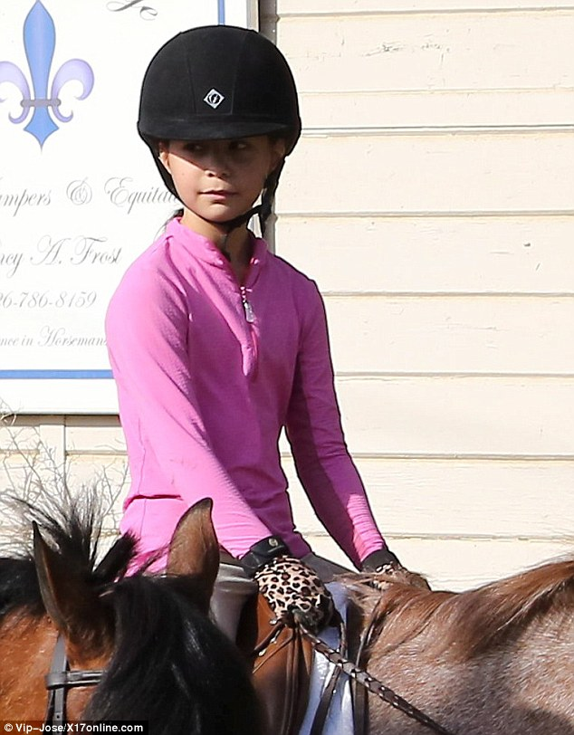 Always prepared! Sam practiced safety first and wore a black helmet during her horseback riding excursion