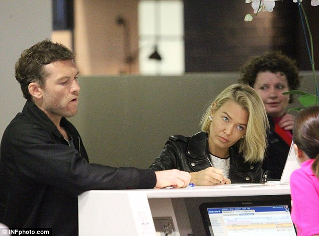 Why so serious? The 37-year-old appeared to be unhappy with the service as he got ready for his flight to Europe