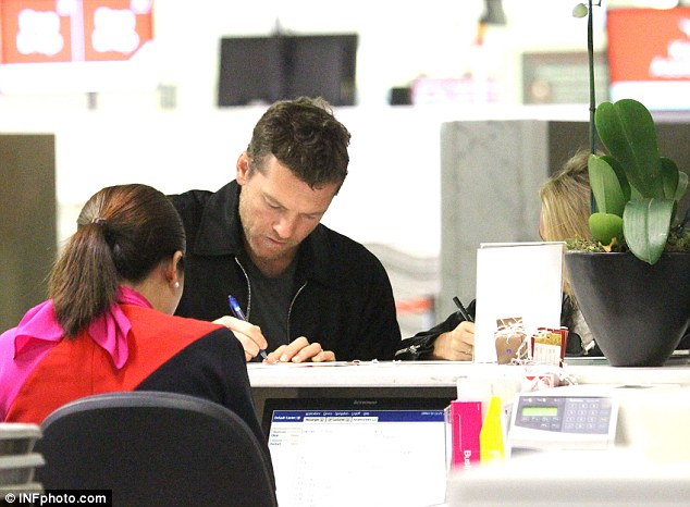 Fair truce: The Avatar actor filled out the documents next to his model girlfriend