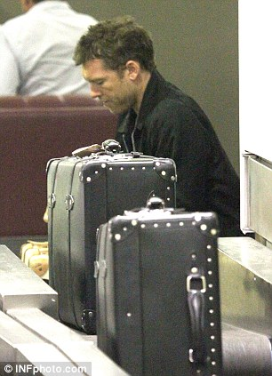 Heavy lifting: Worthington labelled several designer suitcases, bound for Europe