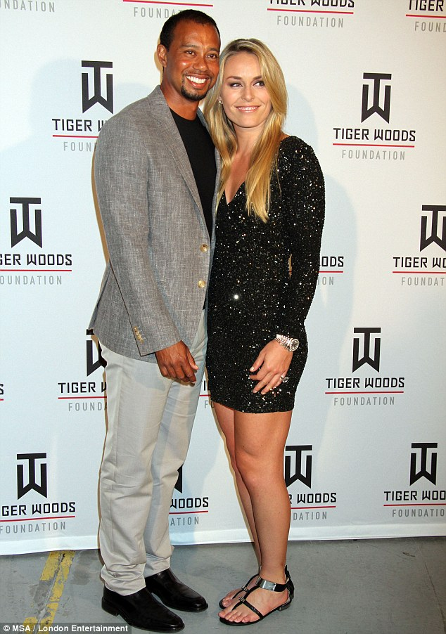 Power couple: Injured Tiger Woods leans on Alpine skier girlfriend Lindsey Vonn, who is recovering from a knee operation, at 16th Tiger Jam gala at Mandalay Bay Hotel in Las Vegas on Saturday