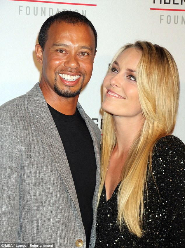 Lean on me: Woods, who is recovering from surgery to relieve pain from a pinched nerve in his back that caused him to miss the Masters, leans on injured girlfriend Lindsey at his annual gala