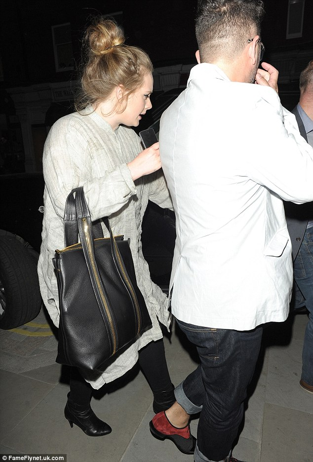 Home time: Adele makes her way to a waiting car after enjoying a night out with pals who included Alan Carr, Nick Grimshaw and Steve Coogan