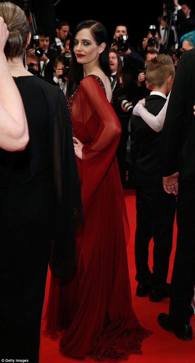 Looking good: The star looked radiant in her maroon-coloured floor-length gown
