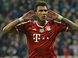 Listen up: Mario Mandzukic, celebrating a goal against United earlier in the season, could be set to join them