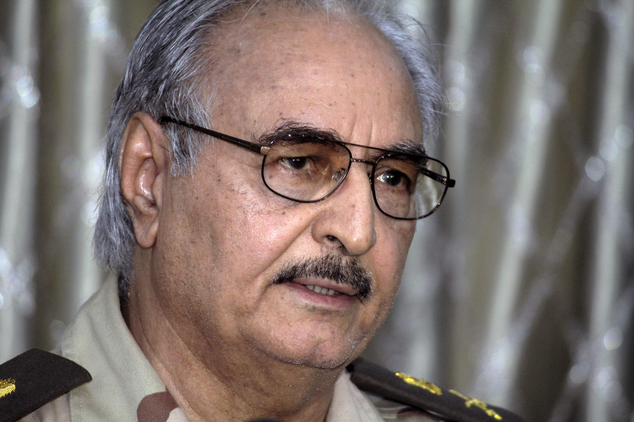 In this Saturday, May 17, 2014 photo, Libyan Gen. Khalifa Hifter addresses a press conference in Benghazi, Libya. The death toll from fighting over the weeke...