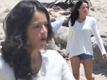 Seventh heaven! Michelle Rodriguez is delightful in denim hotpants as stars muster on the beach to film Fast & Furious sequel