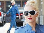 Trendsetter: The Hollaback hitmaker dressed for her acupuncture appointment in a blue long-sleeved jumpsuit, black, white, and purple futuristic high-heeled and high-top trainers, and a pair of large white stylish sunglasses