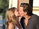 Sean Stewart shares a passionate smooch with model girlfriend Sophia Mondi as they leave charity fundraiser in LA