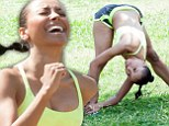 Feel the burn! Flexible Kat Graham stretches after a gruelling run... and shows off her slim but curvy figure in the process