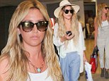 Their very own Hangover? Vanessa Hudgens and Ashley Tisdale shield their eyes in dark sunglasses as they return from bachelorette weekend