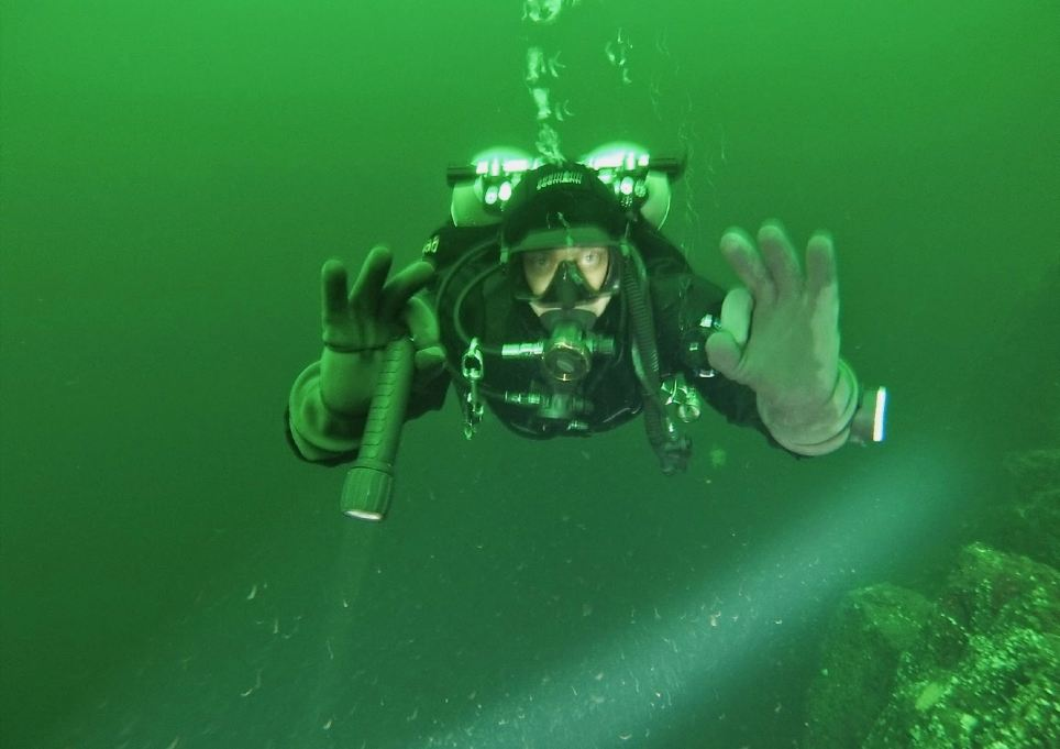 Scientist Evgeny Vasilchenko, another member of the team, poses under the water during the dive near British Columbia, Canada