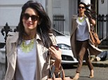 George Clooney's fiancée Amal Alamuddin puts on another effortlessly stylish display in camel trench coat and green statement necklace as she runs errands