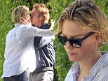 'Partings are such sweet sorrow': Charlize Theron and a blonder Sean Penn blend into one as they share steamy goodbye kiss