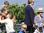Awkward! Tom Brady plants a big kiss on wife Gisele Bundchen as they flaunt their love in front of ex Bridget Moynahan