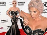 That was close! Kesha adjusts mermaid gown after her cleavage very nearly spills out of it at Billboard Music Awards