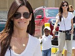 Doting mother Sandra Bullock grips onto the hand of her adorable son Louis during trip to the aquarium