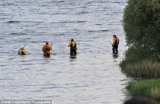 Searchers walked through shallow areas of the lake to see if they could find any sign of the missing man whose body was recovered after 5pm