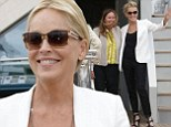 Sharon Stone looks effortlessly chic in a black jumpsuit and white blazer as she boards Roberto Cavalli's yacht in Cannes