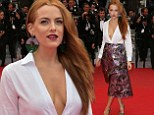 Foxy lady! Riley Keough shows off gaping cleavage in very low-cut white blouse at Cannes Film Festival premiere