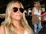 LeAnn at LAX in ripped jeans