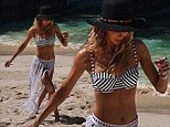 Tassels and a two-piece! Jennifer Hawkins shows off her svelte figure as she strips down on the sands to promote her new swimwear line