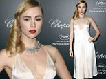 Suki Waterhouse vamps it up with bright red lipstick and plunging silk dress at yet another Cannes bash