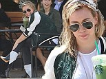 Getting her kicks: Hilary Duff rocks cool '60s Mod monochrome ankle boots and wet hair as she cools off with her favourite green tea frappuccino