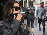 Kim Kardashian steps out for pre-wedding work-out with fiance Kanye West in 'YEEZI' leather jacket while showing off her famous derriere in cropped leggings