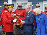 Prince Charles and the Duchess of Cornwall were presented with a toy moose by the Royal Canadian Mounted Police during their trip to Canada yesterday