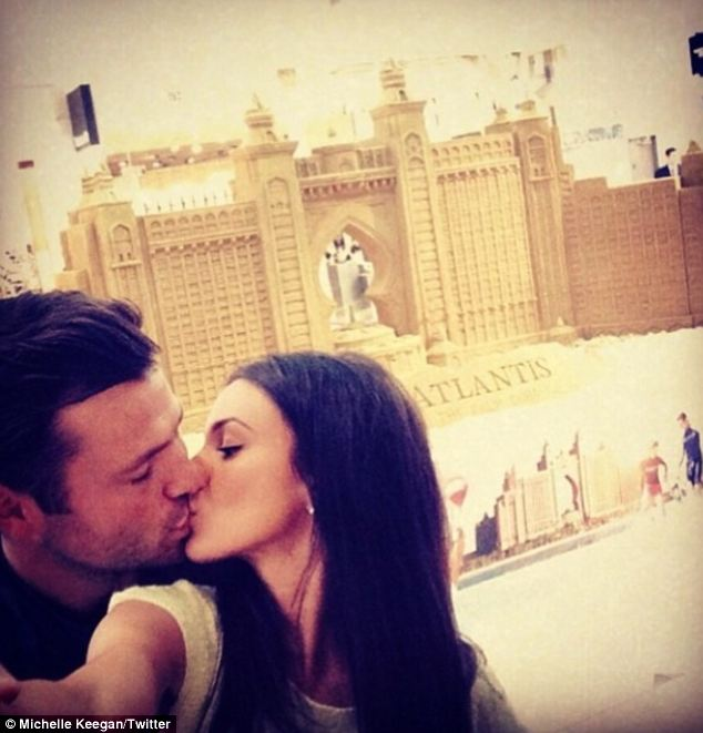 Bringing back memories: Michelle Keegan and Mark Wright pose for a selfie, with the caption: ¿Look what we came across today!!! Our favourite place in the world! #BESTmemories! #Dubai #atlantisselfie¿