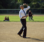 President Barack Obama throws out a baseball as he makes a unannounced stop to surprise members of the Northwest little league baseball teams at Friendship P...