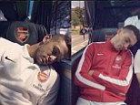 Sleeping beauties: Lukas Podolski snapped pictures of his Arsenal team-mates asleep on Sunday