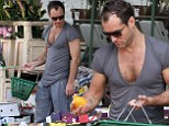 Jude Law puts his man cleavage on full display in deep cut grey top while shopping for groceries