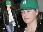 No make-up needed! Kate Upton looks fresh faced as she arrives at LAX while supporting boyfriend Justin Verlander's baseball team
