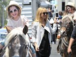 Priceless: Rachel Zoe son's Skyler was too cute for words as he rode a pony at the Farmer's Market in Beverly Hills, California on Sunday
