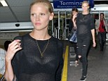 Her arrival will be remembered! Lara Stone leaves little to the imagination in sheer black top as she leads a slew of stars arriving into Cannes